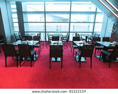 Restaurant in modern building - stock photo