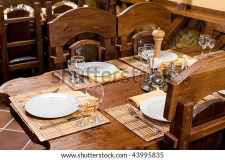 restaurant interior in style of medieval castle with massive wooden furniture