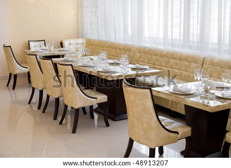 restaurant interior of beige colours with leather seats - stock photo