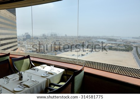 Restaurant Interior of the luxury hotel with a view on Dubai city, UAE
