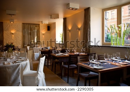 Restaurant interior with served tables - stock photo