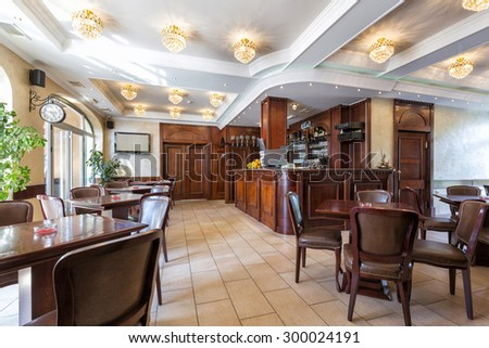 Restaurant interior with wooden counter - stock photo