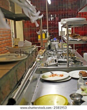 restaurant kitchen depicting food preparation and orders - stock photo