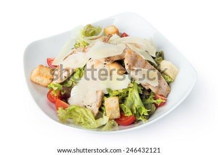 Restaurant meal - caesar salad isolated at the white background - stock photo