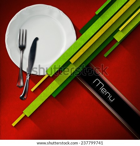 Restaurant Menu Design. Restaurant menu with empty white plate and cutlery, on red velvet background with diagonal green and yellow stripes and diagonal black band - stock photo
