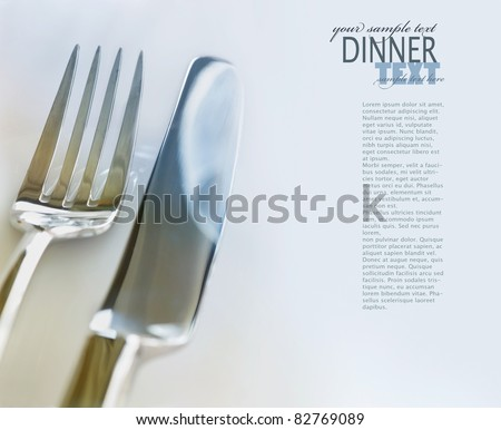 Restaurant Menu food series with copyspace. Fork and knife in elegant table setting - stock photo
