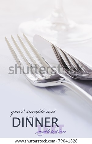 Restaurant Menu series with copyspace. Fork and knife in elegant table setting - stock photo