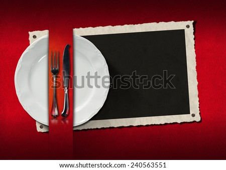 Restaurant Menu with Photo Frame. Empty photo frame with empty white plate and silver cutlery on red velvet background. Template for an elegant restaurant menu - stock photo