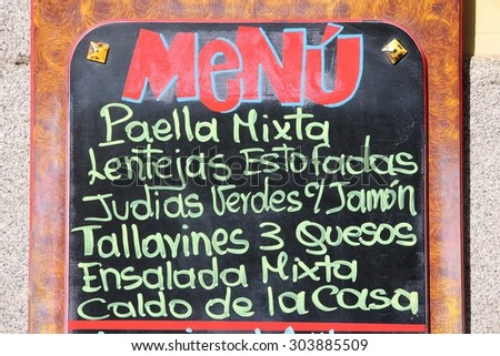Restaurant menu with typical Spanish food - outdoor bar in Madrid, Spain. Generic dish names. - stock photo