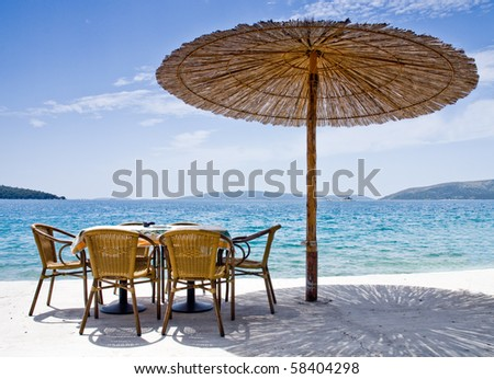 Restaurant near the sea with some islands in the background - stock photo