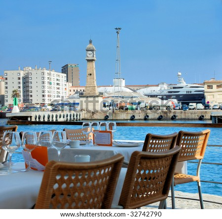 "restaurant on quay in port of Barcelona ""Port Well"" - stock photo"