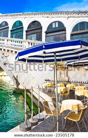 Restaurant on the bank of Grand Canal near Bridge Rialto, Venice, Italy - stock photo