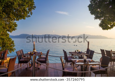 Restaurant on the beach with a view of the Adriatic sea - stock photo