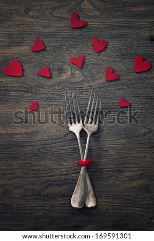 Restaurant series. Valentines day dinner with table setting in rustic wood style with cutlery - stock photo