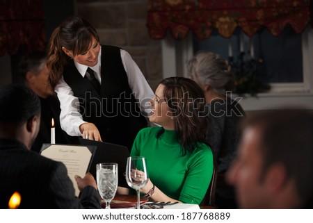 Restaurant: Server Suggests Items For Dinner - stock photo