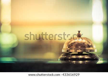 Restaurant service bell vintage with bokeh - stock photo