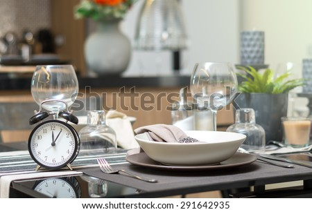 restaurant set with vintage clock at lunch time at Luxury Interior kitchen room background - stock photo