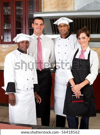 restaurant staff inside industrial kitchen