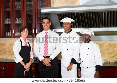 restaurant staff inside industrial kitchen - stock photo