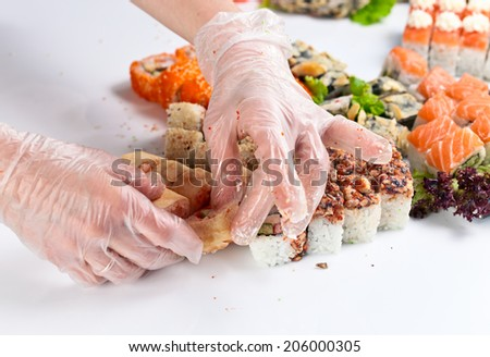 restaurant  staff lays the table with seafood - stock photo