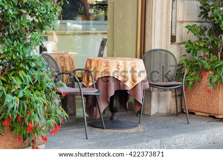 Restaurant table and chairs outdoor, Bellagio, Italy. - stock photo