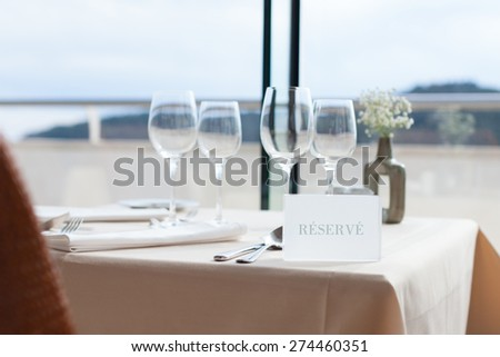 restaurant table by the window - stock photo