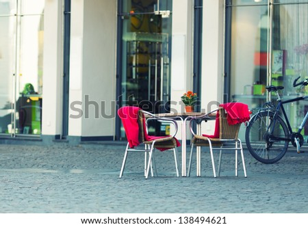 Restaurant table in old european town - stock photo