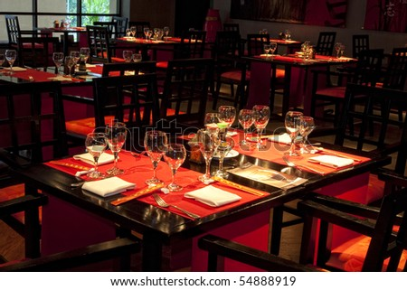 Restaurant table set awaiting guests and food. - stock photo