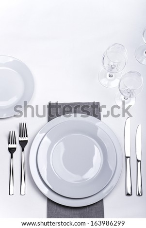 Restaurant table set with grey napkin - stock photo