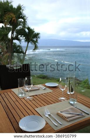 Restaurant table setting on the ocean beach of Hawaii, Maui island - stock photo