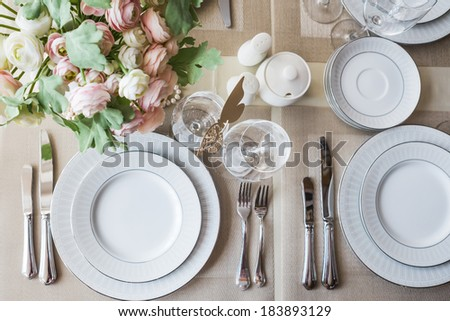 Restaurant table witch empty glasses and plates - stock photo