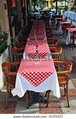 Restaurant tables in a row - stock photo