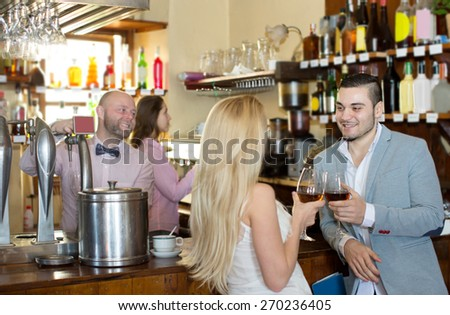 Restaurant visitors waiting for table and drinking wine at tavern - stock photo