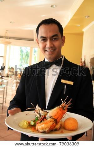 restaurant waiter holding food - stock photo
