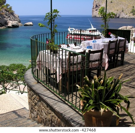 Restaurant with a panoramic beach view - stock photo
