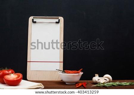 Restaurant wooden table, blank menu and utensil - stock photo