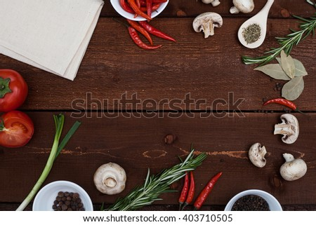 Restaurant wooden table with ingredients and utensil, top view frame - stock photo