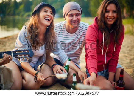 Restful friends spending weekend in natural environment - stock photo