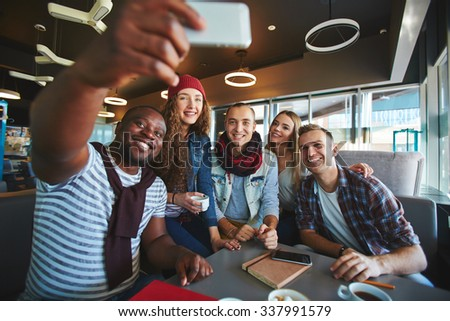 Restful teenagers making selfie while sitting in cafe - stock photo