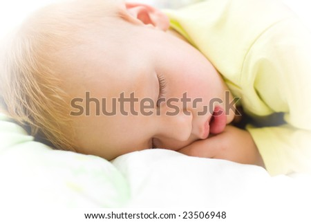 Restful two years baby boy sleeping on bed - stock photo