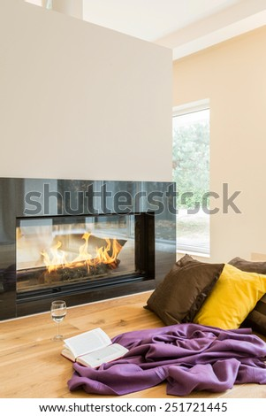 Resting place by the fireplace in a beautiful apartment - stock photo