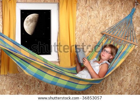 Resting schoolgirl with opened book on a hammock in living room - stock photo