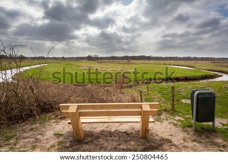 Resting Seat Overlooking the River Valley of the Drentsche Aa, Drenthe, Netherlands - stock photo