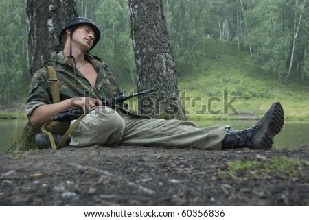 Resting soldier portrait - stock photo