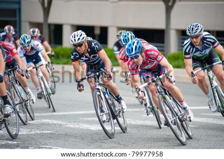 RESTON, VIRGINIA - JUNE 26: Cyclists compete in the Reston Town Center Grand Prix on June 26, 2011 in Reston, Virginia - stock photo