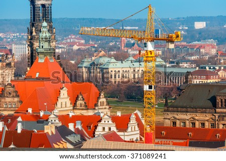 Restoration work in the center of the Old Town in Dresden, building site, crane on the background Hofkirche, Saxony, Germany - stock photo