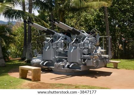 Restored anti-aircraft battery on display at Pearl Harbor, Hawaii. - stock photo
