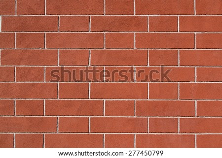Restored old brick wall, exterior surface, good condition - stock photo