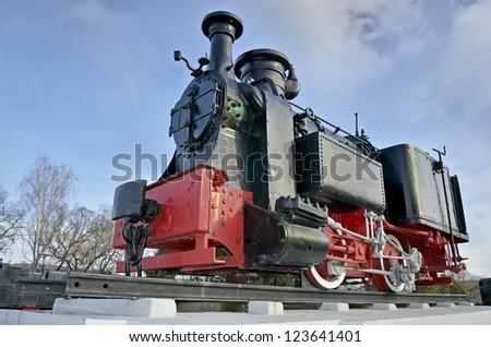 Restored steam engine on railway - stock photo