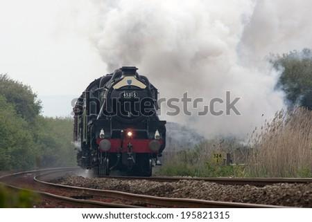 Restored steam engine, 45305, running on the mainline near Penzance, Cornwall, UK. - stock photo